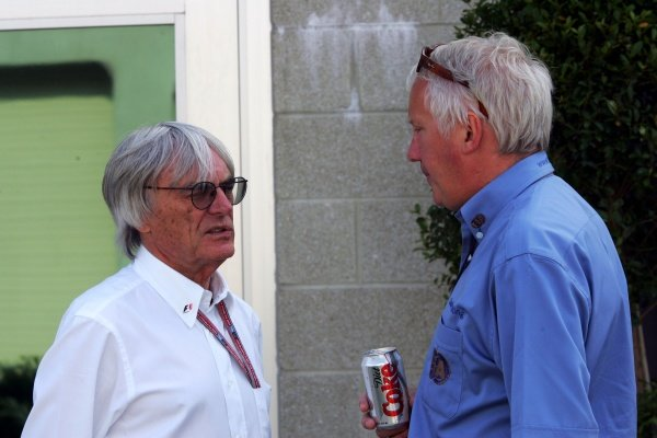(L to R): Bernie Ecclestone (GBR) F1 Supremo talks with Charlie Whiting (GBR) FIA Delegate. Formula One World Championship, Rd 9, United States Grand Prix, Qualifying Day, Indianapolis, USA, 18 June 2005. DIGITAL IMAGE