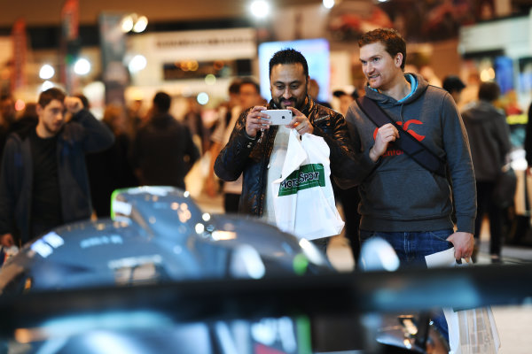 Autosport International Exhibition. National Exhibition Centre, Birmingham, UK. Sunday 15 January 2017. Visitors to the show take a picture of a Ligier. World Copyright: Sam Bagnall/LAT Images Ref: DSC_5750