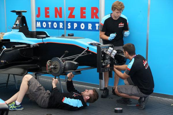 2017 FIA Formula 2 Round 2. Circuit de Catalunya, Barcelona, Spain. Thursday 11 May 2017. Jenzer Motorsport mechanics Photo: Jed Leicester/FIA Formula 2. ref: Digital Image JL1_8992