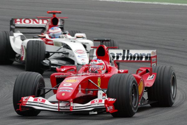 2004 European Grand Prix - Sunday Race,Nurburgring, Germany. 30th May 2004 Rubens Barrichello, Ferrari F2004, leads Jenson Button, BAR Honda 006, action.World Copyright: Steve Etherington/LAT Photographic ref: Digital Image Only