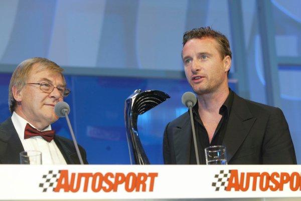 2003 AUTOSPORT AWARDS, The Grosvenor, London. 7th December 2003.Ex Formula One driver, Eddie Irvine hands the John Bolster Award to Ralph Firman Snr.Photo: Peter Spinney/LAT PhotographicRef: Digital Image only