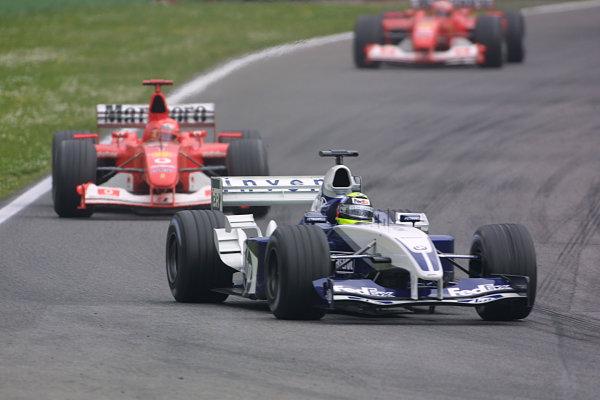 2003 San Marino Grand Prix - Sunday Race,Imola, Italy.20th April 2003.Ralf Schumacher, BMW Williams FW25, leads Michael Schumacher, Ferrari F2002, action.World Copyright LAT Photographic.ref: Digital Image Only.