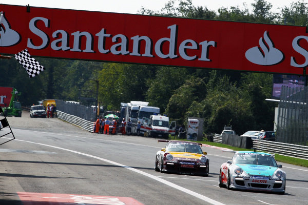 Race winner Nicholas Tandy (GBR) Konrad Motorsport takes the chequered flag at the end of the race.