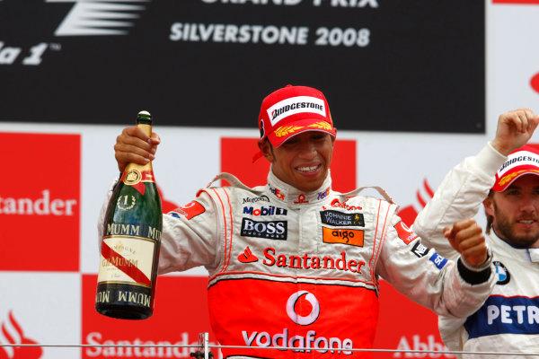 Silverstone, Northamptonshire, UK.6th July 2008.Lewis Hamilton, McLaren MP4-23 Mercedes, 1st position, sprays the champagne on the podium. Portrait. Podium. World Copyright: Charles Coates/LAT Photographic.ref: Digital Image _26Y5339