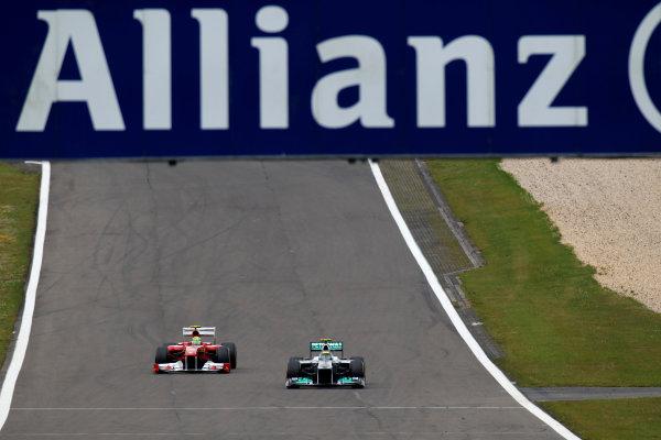 Nurburgring, Germany24th July 2011Nico Rosberg, Mercedes GP W02, 7th position, leads Felipe Massa, Ferrari 150° Italia, 5th position. Action. World Copyright:Glenn Dunbar/LAT Photographicref: Digital Image C27C4572