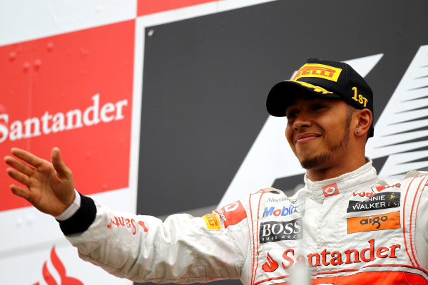 Nurburgring, Germany.24th July 2011Lewis Hamilton, McLaren MP4-26 Mercedes, 1st position, on the podium. Portrait. Podium. World Copyright: Andy Hone/LAT Photographicref: Digital Image CSP13410