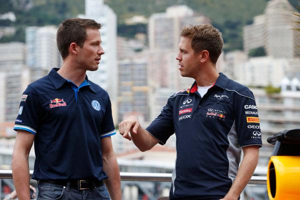 Monte Carlo, Monaco 22nd May 2013 Sebastian Vettel, Red Bull Racing meets Sebastian Ogier World Copyright: Glenn Dunbar/LAT Photographic ref: Digital Image _89P7369