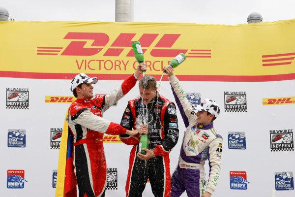 14-15 June, 2013, West Allis, Wisconsin USA Sage Karam, Zach Veach and Carlos Munoz Celebrate on  the podium with sparkling grape juice ©2013, Phillip Abbott LAT Photo USA
