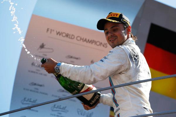Autodromo Nazionale di Monza, Monza, Italy. Sunday 06 September 2015. Felipe Massa, Williams F1, 3rd Position, sprays Champagne from the podium. World Copyright: Glenn Dunbar/LAT Photographic. ref: Digital Image _89P8741