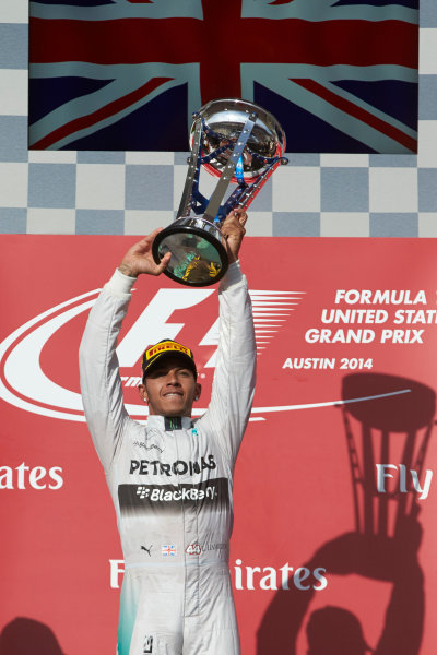 Circuit of the Americas, Austin, Texas, United States of America. Sunday 2 November 2014. Lewis Hamilton, Mercedes AMG lifts the trophy as he celebrates on the podium after winning the race. World Copyright: Steve Etherington/LAT Photographic. ref: Digital Image SNE10245
