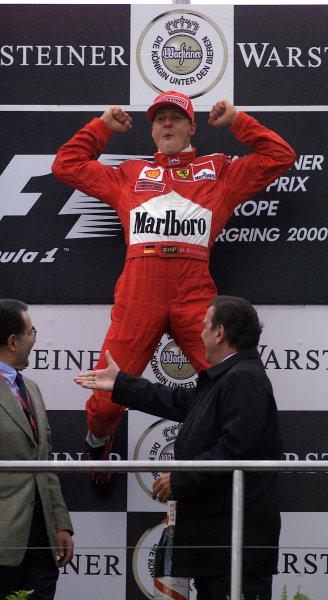 2000 European Grand Prix.Nurburgring, Germany. 19-21 May 2000.Michael Schumacher (Ferrari) celebrates his 1st position on the podium.World Copyright - Steve Etherington/LAT Photographic18mb Digital