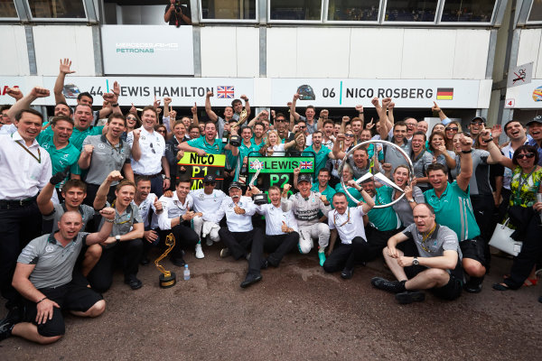 Monte Carlo, Monaco. Sunday 25 May 2014. Nico Rosberg, Mercedes AMG, 1st Position, Lewis Hamilton, Mercedes AMG, 2nd Position, Toto Wolff, Executive Director (Business), Mercedes AMG, Dr Dieter Zetsche, CEO, Mercedes Benz, Paddy Lowe, Executive Director (Technical), Mercedes AMG, and the Mercedes AMG team celebrate. World Copyright: Steve Etherington/LAT Photographic. ref: Digital Image SNE20211 copy