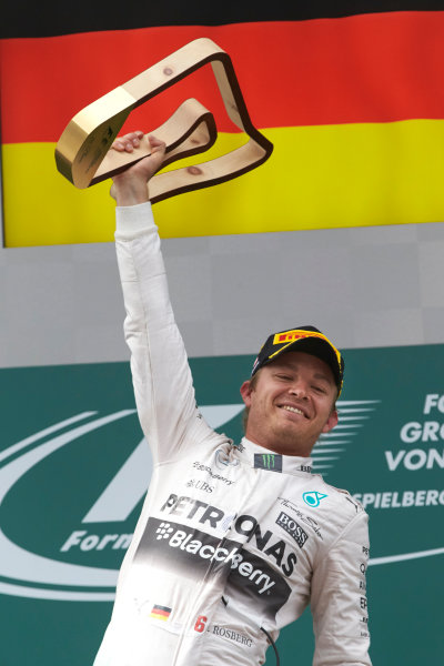 Red Bull Ring, Spielberg, Austria. Sunday 21 June 2015. Nico Rosberg, Mercedes AMG, 1st Position, celebrates with his trophy. World Copyright: Steve Etherington/LAT Photographic. ref: Digital Image SNE24748