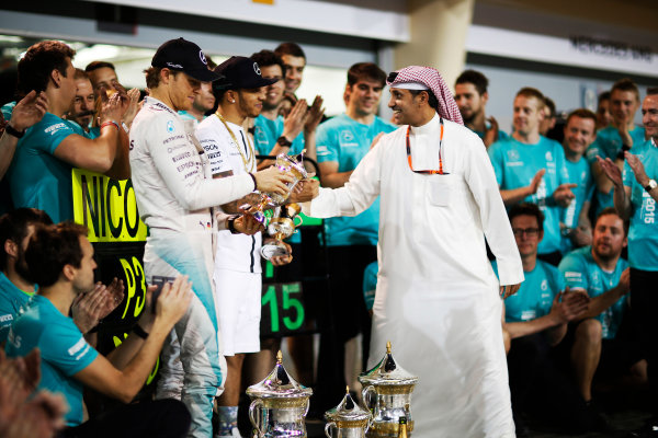 Bahrain International Circuit, Sakhir, Bahrain. Sunday 19 April 2015. Lewis Hamilton, Mercedes AMG, 1st Position, Nico Rosberg, Mercedes AMG, 3rd Position, and the Mercedes team celebrate victory. World Copyright: Alastair Staley/LAT Photographic. ref: Digital Image _R6T1251