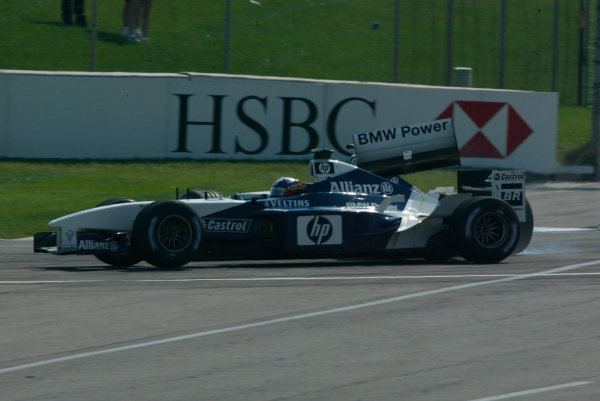 2002 American Grand Prix.Indianapolis, Indiana, USA. 27-29 September 2002.Ralf Schumacher (Williams FW24 BMW) spins and collides with team mate Juan-Pablo Montoya, losing his rear wing in the process on lap 2.World Copyright - LAT Photographicref: Digital File Only