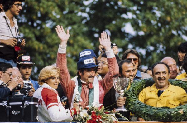 Clay Regazzoni celebrates victory on the podium.