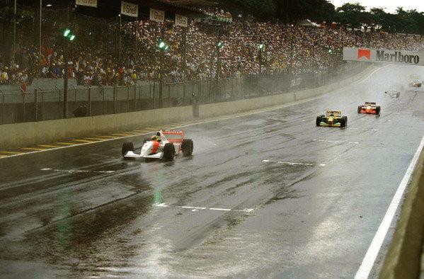 Ayrton Senna, McLaren MP4-8 Ford, leads Michael Schumacher, Benetton B193A Ford.