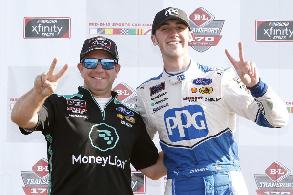#22: Austin Cindric, Team Penske, Ford Mustang PPG celebrates in victory lane with crew chief Brian Wilson