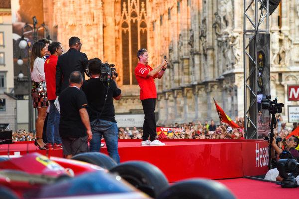 Sebastian Vettel, Ferrari takes a photo from the stage