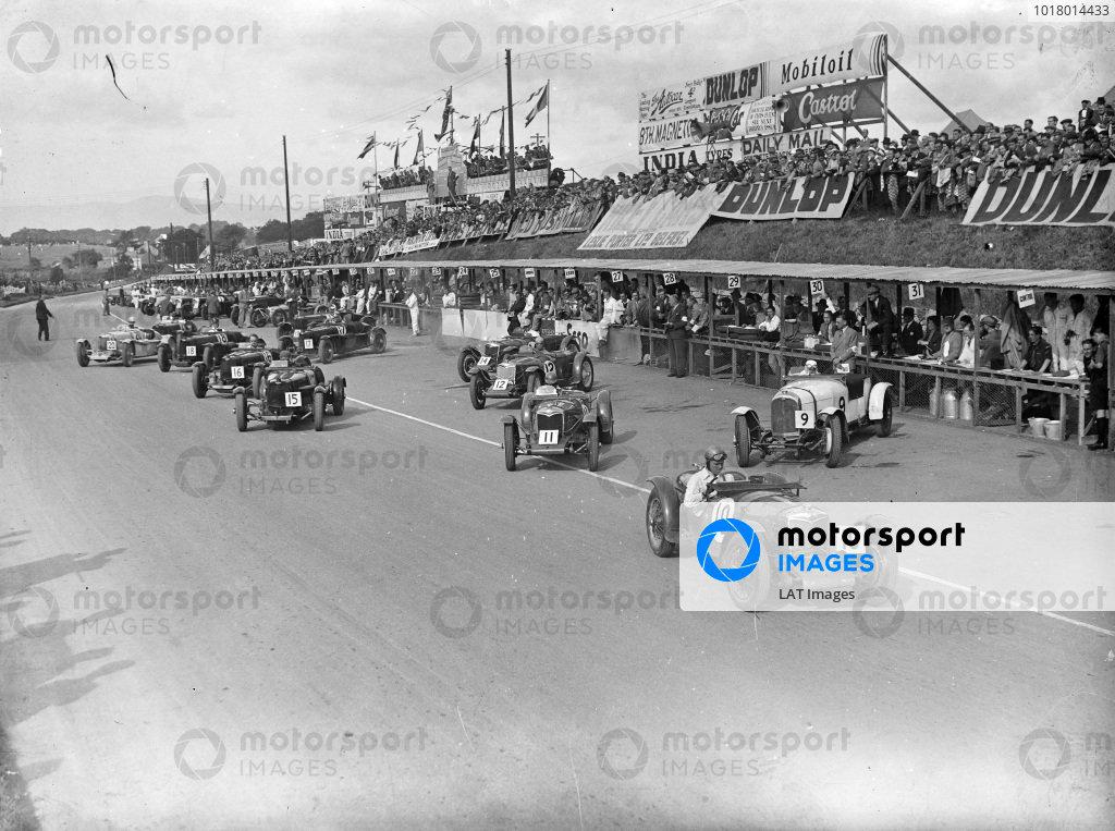 Freddie Dixon, Riley TT Sprite, leads Cyril Paul, V. Riley, Riley TT Sprite (#11), and Charles Martin, A. C. Bertelli, Aston Martin 1.5, at the start.
