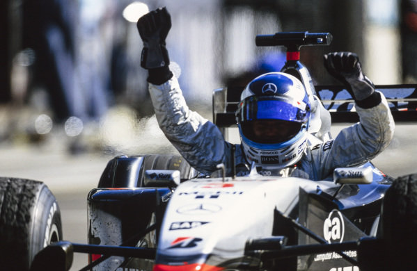 Mika Häkkinen, McLaren MP4-16 Mercedes, celebrates victory which would turn out to be his final in F1.
