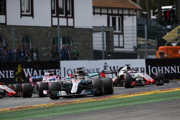 Lewis Hamilton, Mercedes AMG F1 W09, ; Sebastian Vettel, Ferrari SF71H, Sergio Perez, Racing Point Force India VJM11, Esteban Ocon, Racing Point Force India VJM1, and Romain Grosjean, Haas F1 Team VF-18, at the start.