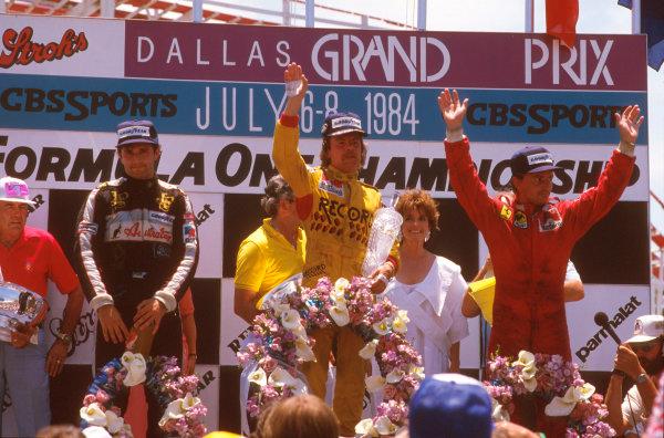 Fair Park, Dallas, Texas, USA.6-8 July 1984.Keke Rosberg (Williams Honda) 1st position, Elio de Angelis (Team Lotus) 2nd position and Rene Arnoux (Ferrari) 3rd position on the podium.Ref-84 DAL 08.World Copyright - LAT Photographic