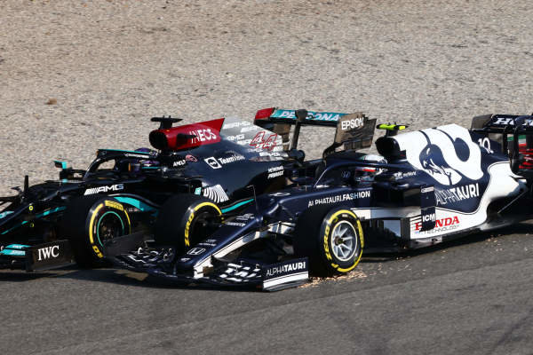 Sir Lewis Hamilton, Mercedes W12, battles with Pierre Gasly, AlphaTauri AT02, on the opening lap