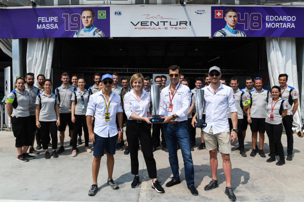 Edoardo Mortara (CHE) Venturi Formula E, and Susie Wolff, Team Principal, Venturi Formula E, receive the winners' trophies from the previous race in Hong Kong, in which Mortara was declared the winner post-race. Felipe Massa (BRA), Venturi Formula E, is also present with the remainder of the Venturi team.
