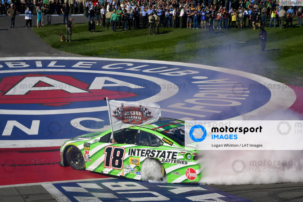 #18: Kyle Busch, Joe Gibbs Racing, Toyota Camry Interstate Batteries celebrates with a burnout after winning