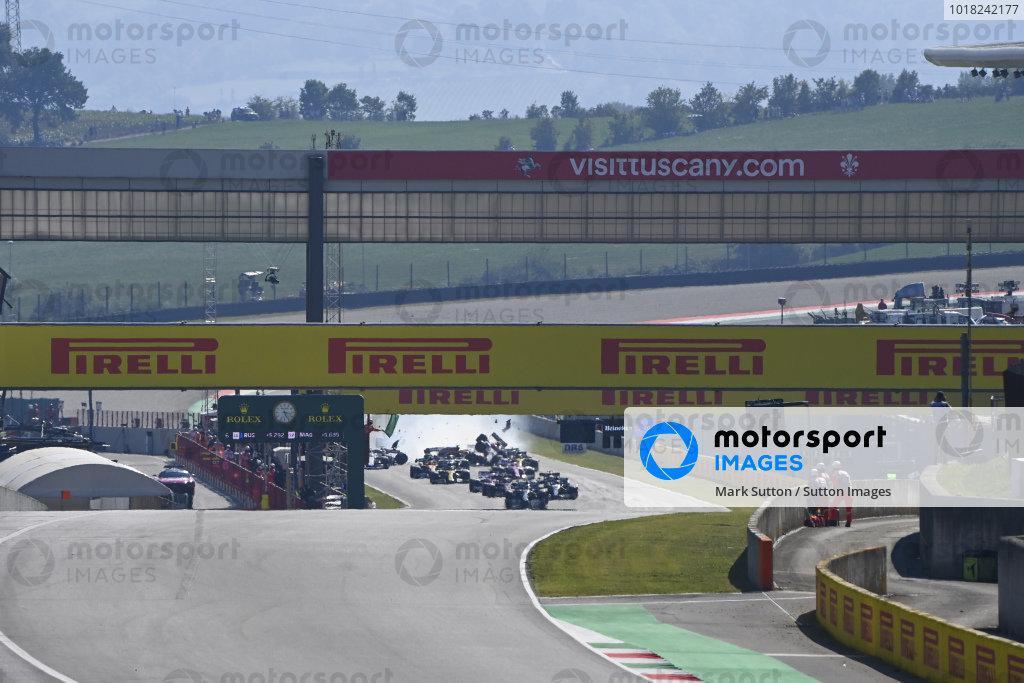 Valtteri Bottas, Mercedes F1 W11 EQ Performance, leads Lewis Hamilton, Mercedes F1 W11 EQ Performance, Charles Leclerc, Ferrari SF1000, and the rest of the field as a crash develops behind