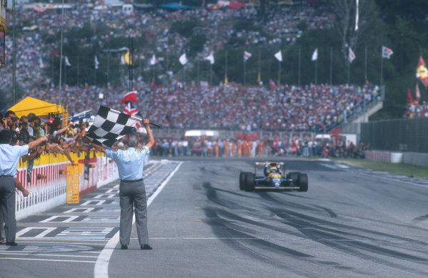 1990 San Marino Grand Prix.Imola, Italy.11-13 May 1990.Riccardo Patrese (Williams FW13B Renault) celebrates as he approaches the finish line to take the chequered flag for 1st position and his first win in over six years.Ref-90 SM 13.World Copyright - LAT Photographic