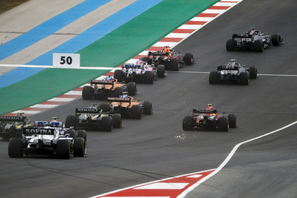 Lewis Hamilton, Mercedes F1 W11 EQ Performance, leads Max Verstappen, Red Bull Racing RB16, Valtteri Bottas, Mercedes F1 W11 EQ Performance, Charles Leclerc, Ferrari SF1000, Sergio Perez, Racing Point RP20, and the rest of the field on the opening lap