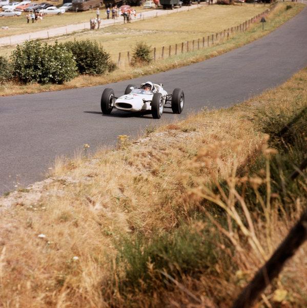 Nurburgring, Germany. 31/7-2/8 1964.  Ronnie Bucknum (Honda RA271) at Flugplatz.  Ref-3/1370. World Copyright - LAT Photographic