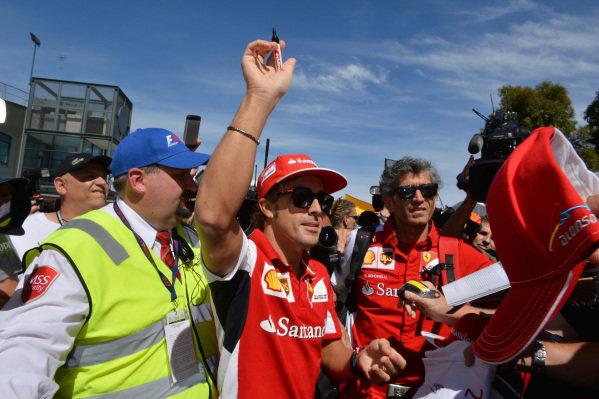 Fernando Alonso (ESP) Ferrari signs autographs for the fans.Formula One World Championship, Rd1, Australian Grand Prix, Preparations, Albert Park, Melbourne, Australia, Thursday 13 March 2014.