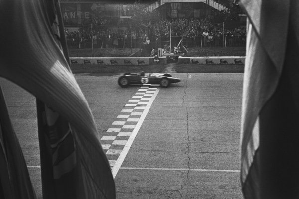 Monza, Italy. 6th - 8th September 1963.  Jim Clark (Lotus 25 Climax),1st position, crosses the finishing line clinching the drivers and constructors World Championship titles, action. World Copyright: LAT Photographic.  Ref: L63 - 282 - 19