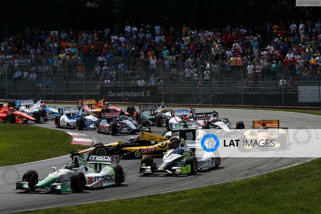 1-3 August, 2014, Lexington, Ohio USA Sebastien Bourdais leads the start as Tony Kanaan gets sideways crash ©2014, Michael L. Levitt LAT Photo USA