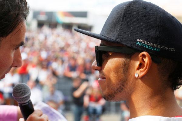 Hockenheimring, Hockenheim, Germany. Saturday 19 July 2014. Lewis Hamilton, Mercedes AMG, is interviewed on stage. World Copyright: Charles Coates/LAT Photographic. ref: Digital Image _J5R4536