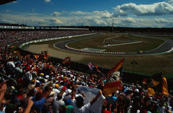 The large crowd in the Hockenheim stadium cheer on the drivers. German Grand Prix, Hockenheim, 25 July 1993