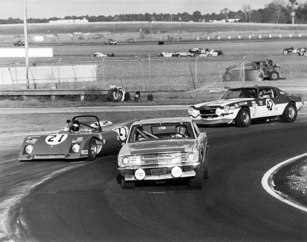 1971 Daytona 24 Hours. Daytona, Florida, USA. 30th - 31st January 1971. Rd 2. Netsor Garcia-Veiga / Luigi Chinetti, Jr. / Alain De Cadenet   (Ferrari 312P), 5th position leads Javier Garcia / Luis Sereix / Richard Small (Chevrolet Camaro), 13th position, action.  World Copyright: LAT Photographic.