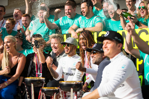 Circuit of the Americas, Austin Texas, USA. Sunday 23 October 2016. Lewis Hamilton, Mercedes AMG, 1st Position, the Mercedes team and celebrities including Skier Lindsey Vonn, Actress Noomi Rapace, TV Chef Gordon Ramsay and Tennis star Venus Williams, celebrate after the race. World Copyright:Andrew Hone/LAT Photographic ref: Digital Image _ONY9019