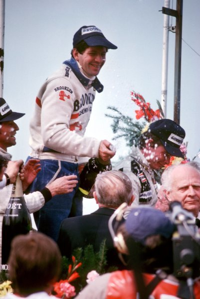 The podium (L to R): Jacques Laffite (FRA) Ligier, second; Jody Scheckter (RSA) Ferrari, winner; Didier Pironi (FRA) Tyrrell, third.