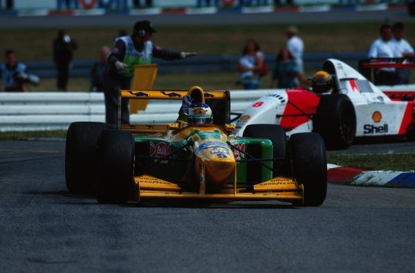 Michael Schumacher (GER) Benetton B193B waves to the German fans after taking 2nd place.