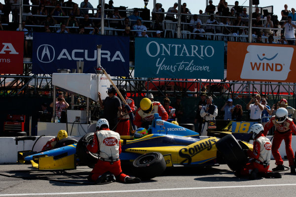 14 July, 2013, Toronto, Ontario, Canada Mike Conway pit stop © 2013, Michael L. Levitt LAT Photo USA