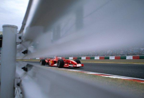 2003 Japanese Grand PrixSuzuka, Japan. 10th - 112th October 2003.Rubens Barrichello, Ferrari F2003 GA, action.World Copyright: Charles Coates / LAT Photographic ref: 35mm Image 03JAP08