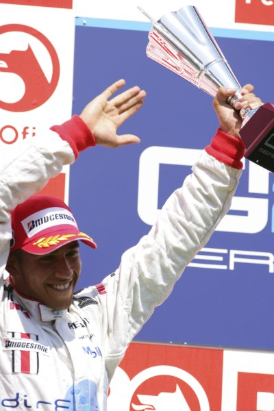 2006 GP2 Series. Round 10. Istanbul Park, Istanbul Turkey. 27th August 2006. Sunday Race. Lewis Hamilton (GBR, ART Grand Prix) celebrates his second position on the podium. World Copyright: Lorenzo Bellanca/GP2 Series Media Service. ref: Digital Image ZD2J8634
