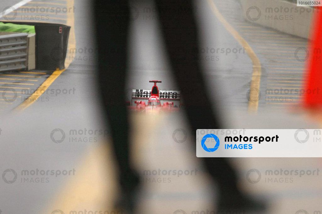Michael Schumacher, Ferrari F2002, approaches his pit crew.