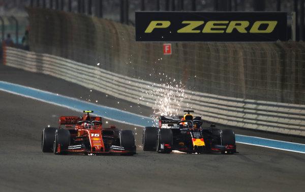 Max Verstappen, Red Bull Racing RB15, battles with Charles Leclerc, Ferrari SF90