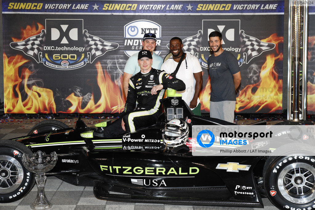 Josef Newgarden, Team Penske Chevrolet celebrates with  guests in victory lane