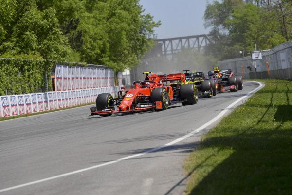 Charles Leclerc, Ferrari SF90, leads Daniel Ricciardo, Renault R.S.19, and Pierre Gasly, Red Bull Racing RB15